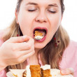 Woman eating cake — Stock Photo
