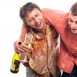 Stock Photo: Drunken men partying with alcohol