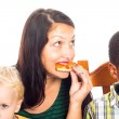 Woman with kids eating pizza — Stock Photo