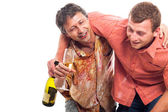 Drunken men partying with alcohol — Stock Photo