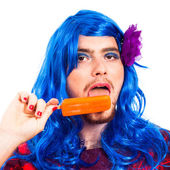 Transvestite man with ice pop — Stock Photo