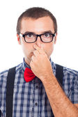 Nerd man holding nose — Stock Photo
