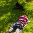 Stock Photo: Child boy sleeping in grass
