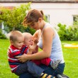 Stock Photo: Happy mother playing with children