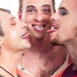 Funny transvestites sticking out tongue — Stock Photo #19416043