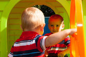 Two little brothers in playhouse — Stock Photo