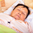 Stock Photo: Senior womsleeping