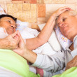 Loving seniors in bed — Stock Photo
