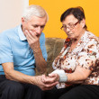 Stock Photo: Worried seniors measuring blood pressure