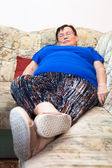 Obese senior woman sleeping — Stock Photo