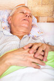 Senior man sleeping — Stock Photo