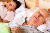 Senior couple sleeping — Stock Photo