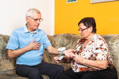 Seniors measuring blood pressure — Stock Photo