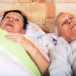 Senior couple resting in bed — Stock Photo #21514365