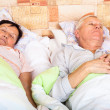 Senior man and woman sleeping — Stock Photo