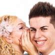 Happy couple whispering — Stock Photo