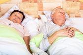 Senior man and woman sleeping — Stock Photo