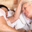 Two seniors relax in bed — Stock Photo