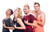 Funny three men cross-dressing and one woman — Stock Photo