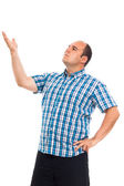 Serious pensive man pointing up — Stock Photo