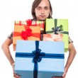 Stock Photo: Man carrying many gifts