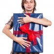 Satisfied man with big gift — Stock Photo