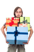 Man carrying many gifts — Stock Photo
