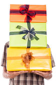 Generous man carrying gifts — Stock Photo