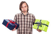 Indecisive man with two gifts — Stock Photo
