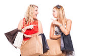 Ecstatic friends shopping — Stock Photo