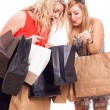 Ecstatic girls with shopping bags — Stock Photo