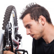 Man repairing bicycle — Stock Photo