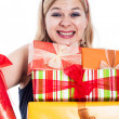 Stockfoto: Ecstatic womwith many presents