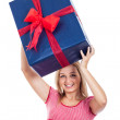 Happy woman lifting big present — Stock Photo