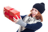 Surprised winter woman with present — Stock Photo