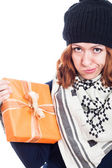 Disappointed woman with present — Stockfoto