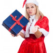 Christmas woman with present sending kiss — Stock Photo