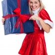 Christmas woman opening big present — Stock Photo