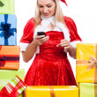 Christmas womtexting message with phone — Stock Photo #29495667