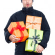 Surprised winter man with presents — Stock Photo