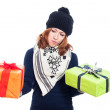 Indecisive woman with presents — Stock Photo