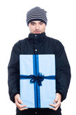 Surprised man with big present — Photo
