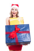 Ecstatic Christmas woman with presents — Stock Photo