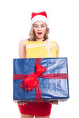 Surprised Christmas woman with presents — Stock Photo