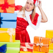 Nervous Christmas woman with presents — Stock Photo