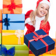 Stock Photo: Ecstatic Christmas womgiving presents