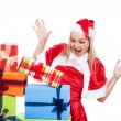 Surprised Christmas woman looking at presents — Photo