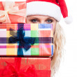 Secret Christmas woman behind presents — Stock Photo