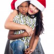 Christmas family in Santa hat — Stock Photo