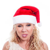 Christmas woman sticking out tongue — Stock Photo
